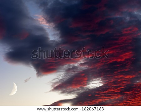 Unusual atmospheric effect of sunset clouds, deep fire red and blue, surreal dreamy cinematic atmosphere - stock photo