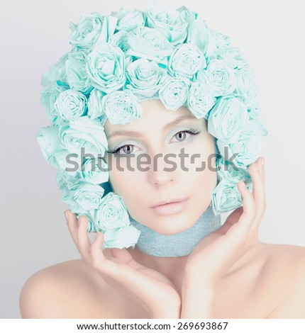 unusual fashion portrait of Young woman with flowers hair. Beauty model girl.Beautiful Girl with blue flowers on her head - stock photo