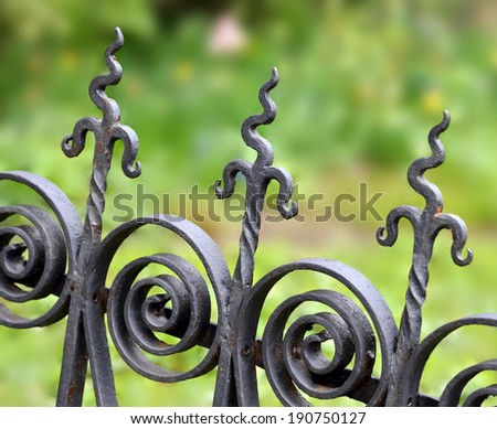 Unusual iron fence pattern - stock photo