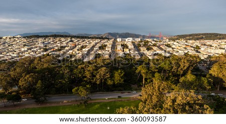 Unusual panoramic view from above San Francisco's Golden Gate Park showing Lands End, the Presidio, The Richmond District, and in the distance the Marin Headlands and Golden Gate Bridge - stock photo
