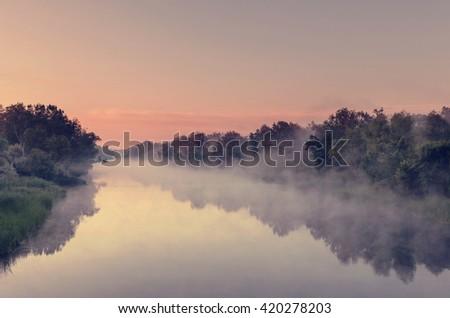 Unusual river fog in summer season - stock photo