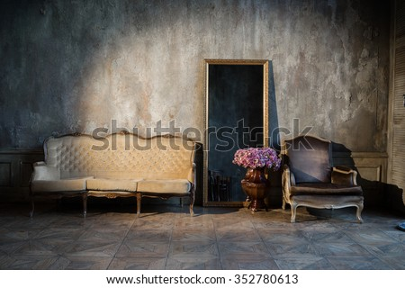 Unusual, vintage interior with a sofa and a mirror - stock photo