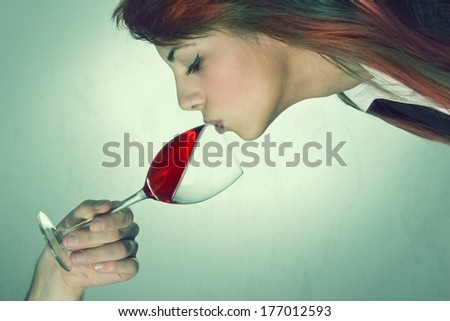 Unusual wine tasting, portrait of young woman - stock photo
