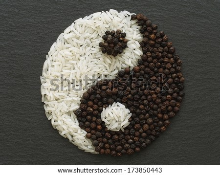 Unusual Yin Yang made of food and condiments - stock photo