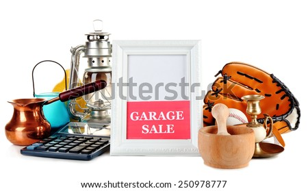 Unwanted things ready for a garage sale, isolated on white - stock photo