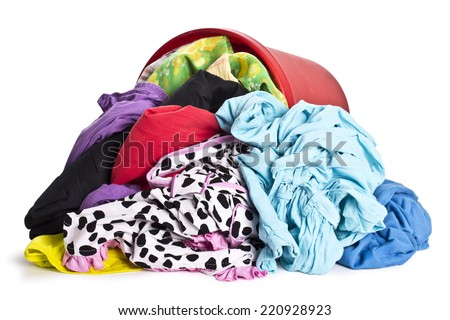 unwashed cloth in the basket on white background - stock photo