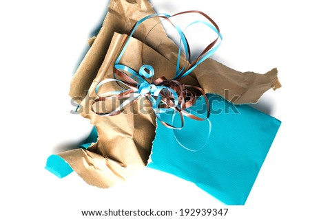 Unwrapped wrapping paper and ribbon at an angle - stock photo