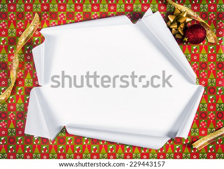 Unwrapping gifts by ripping the paper and revealing the content - stock photo
