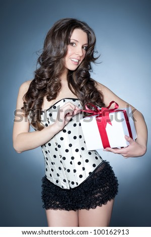 Unwrapping the gift - stock photo