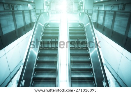 Up and down escalators - stock photo