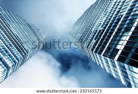 up looking the modern business office building exterior and sky - stock photo