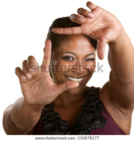 Upbeat Black woman using a framing gesture - stock photo