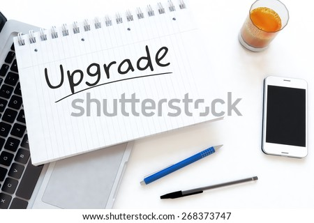 Upgrade - handwritten text in a notebook on a desk - 3d render illustration. - stock photo