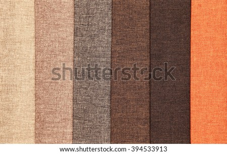 Upholstery textile materials variety shades of brown and orange - stock photo