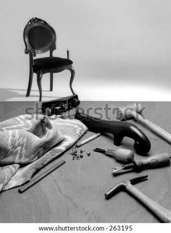 Upholstery tools, chair and fabric - stock photo