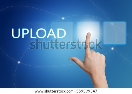 Upload - hand pressing button on interface with blue background. - stock photo