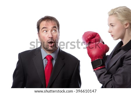 Upper body shot of two co-workers getting ready for a fight, one wearing boxing gloves.  isolated on white - stock photo
