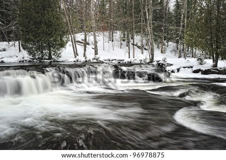 Upper Bond Falls in winter,Paulding Michigan USA - stock photo