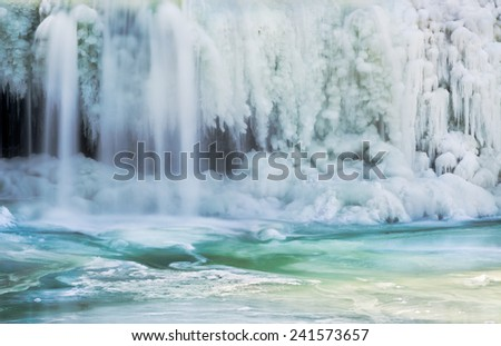 Upper Cataract Falls, a waterfall in Indiana, is shown with smooth flowing water and amazing ice formations from extreme winter cold. - stock photo