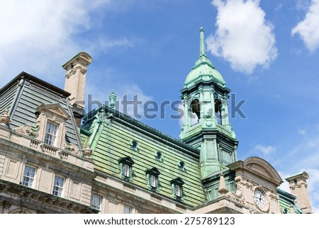 Upper detail of the facade of Montreal City Hall. It was built by Henri-Maurice Perrault and Alexander Cowper Hutchison, between 1872 and 1878 in Second Empire Style. Montreal, Quebec, Canada. - stock photo