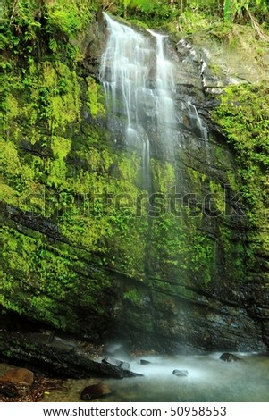 Upper falls and pool on Cascada Juan Diego in the El Yunque rainforest in the Caribbean National Forest, Puerto Rico - stock photo
