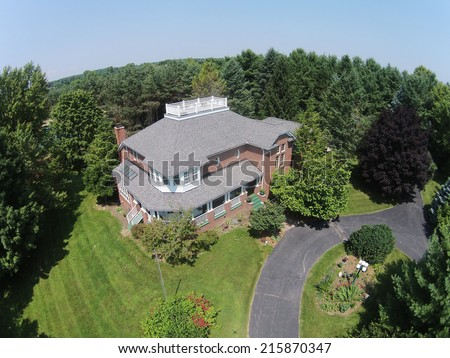 Upscale home in the USA Midwest aerial view - stock photo