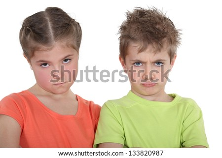 Upset brother and sister - stock photo