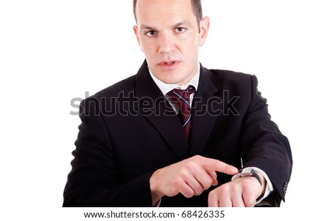 upset businessman pointing to the watch, isolated on white background. Studio shot. - stock photo