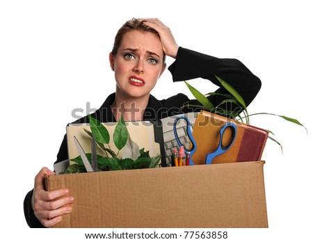 Upset businesswoman carrying office belongings after loosing job - stock photo