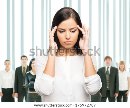 Upset businesswoman has a head ache. She is tired of her work, office and colleagues. - stock photo