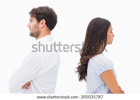 Upset couple not talking to each other after fight on white background - stock photo