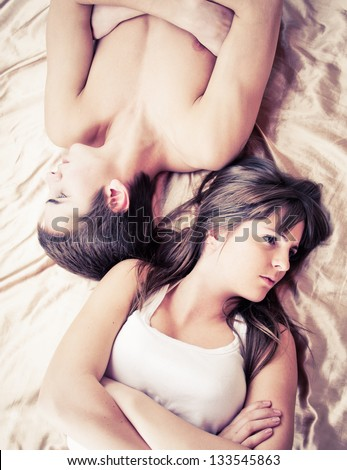 Upset couple sleeping separately on their bed - stock photo