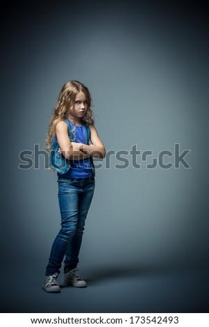 Upset little girl in studio - stock photo