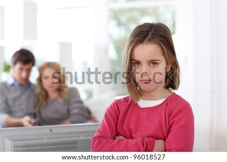 Upset little girl prohibited to watch tv - stock photo