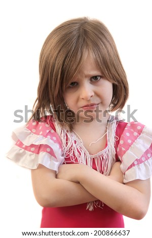 Upset little young girl with arms crossed in disappointment - stock photo