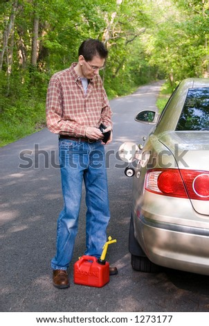 Upset man  on a country road, staring into his wallet while a gas can is at his feet.  Will he be able to pay for the gas for the empty gas tank of his car? - stock photo
