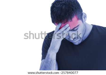 Upset man standing with his hand holding his forehead on white background - stock photo