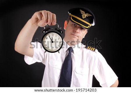 Upset pilot waiting for late passengers - stock photo