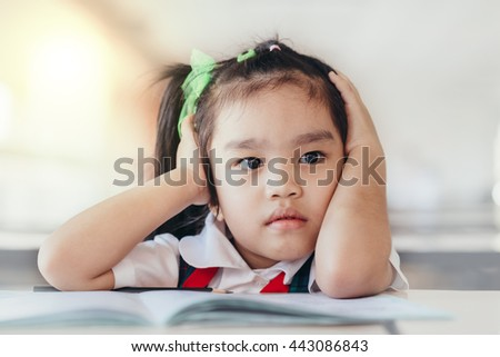 Upset problem child with head in hands - stock photo