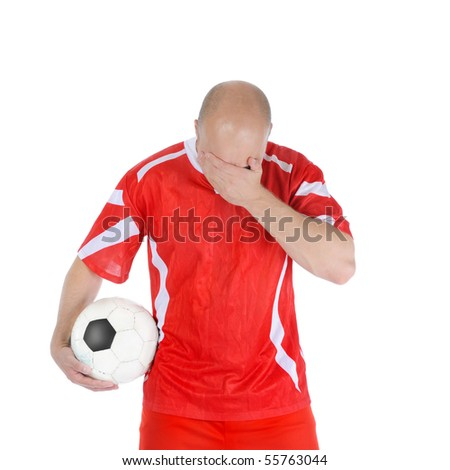 Upset soccer player in the red form. Isolated on white background - stock photo
