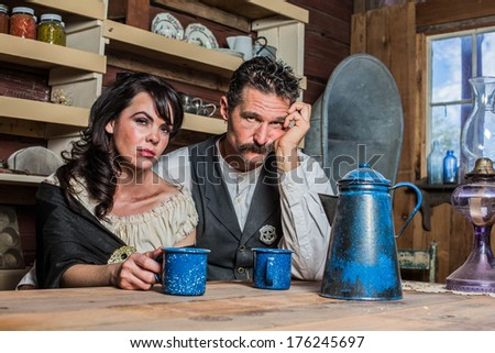 Upset Western Sheriff Poses With a Woman Inside of a House - stock photo