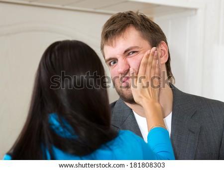 Upset woman slap her partner - stock photo