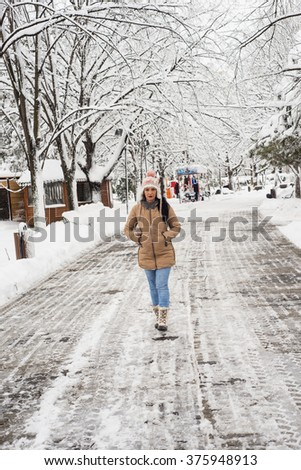 Upset woman walking in park and thinking - stock photo