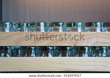 upside down wine glasses in the black leather tray - stock photo
