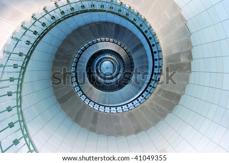 Upside view into the spiral of a lighthouse in France - stock photo