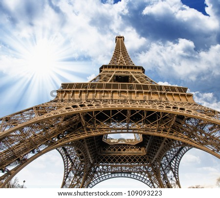 Upward Fisheye view of Eiffel Tower in Paris on a sunny winter morning - France - stock photo