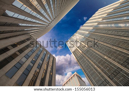 Upward street view of tall Skyscrapers. - stock photo