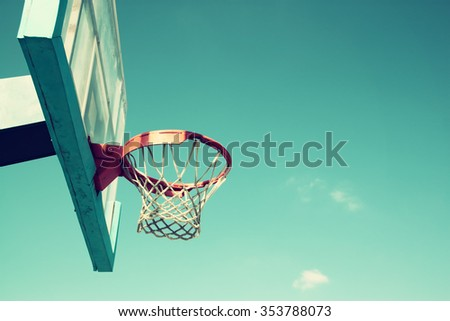 upward view of basketball hoop against sky - stock photo