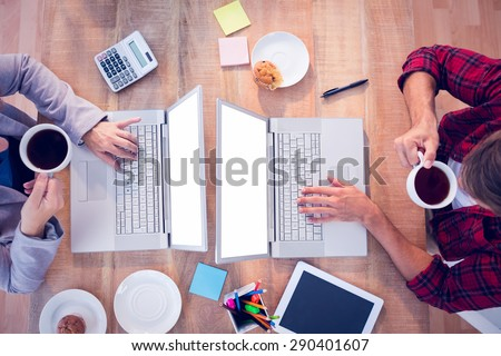 Upward view of creative businessmen drinking a cup of tea - stock photo