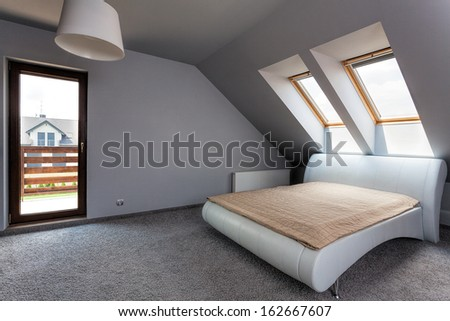 Urban apartment - modern bedroom on the attic - stock photo
